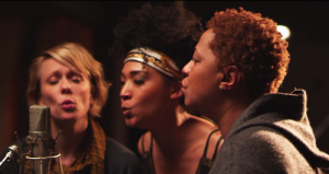 "From the film's official website: ""Jo Lawry, Judith Hill, and Lisa Fischer at the mic for a stirring rendition of 'Lean on Me'."" Fitting, no?"